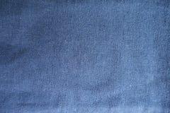 简单的蓝色亚麻制织品从上面 免版税库存照片