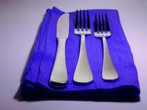 简单蓝色的餐位餐具 库存图片