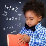 算术教训的小男孩 免版税图库摄影