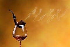 管子和白兰地酒 免版税库存图片