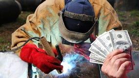 管道焊工薪金作为概念 免版税库存照片