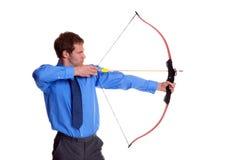 箭头弓生意人侧视图 免版税库存照片