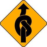 箭头被打结的符号 免版税图库摄影