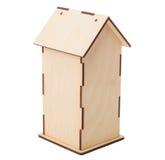 箱子在白色背景的茶 房子的后方 库存图片