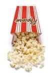 溢出的玉米花箱子 免版税库存图片