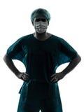 篡改外科医生与面罩剪影的人画象 免版税库存照片