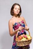 篮子果子充分的女孩藏品 免版税图库摄影