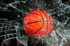 篮球通过玻璃 免版税库存照片