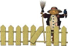 篱芭和稻草人 库存图片