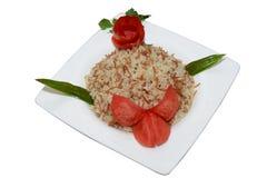 米和开胃菜白色板材 免版税库存照片