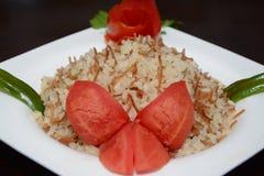 米和用在白色板材的开胃菜 免版税库存照片