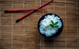 米和筷子板材  图库摄影