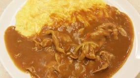 米咖喱用鸡蛋和日语切的猪肉 图库摄影