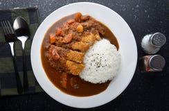 米用被油炸的猪肉和咖喱 免版税库存照片