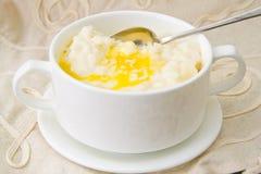 米粥用甜黄油、果酱和咖啡 免版税库存图片