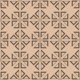 米黄和棕色几何装饰品 无缝的模式 免版税库存照片