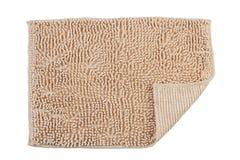 米黄地毯颜色擦鞋垫 免版税库存照片