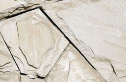 米黄墙壁由几何石头做成 免版税库存图片