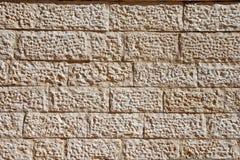 米黄石纹理墙壁 图库摄影