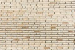 米黄砖墙背景 免版税库存照片