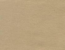 米黄纺织品背景 库存照片