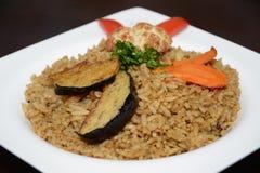 米,用在白色板材的开胃菜 免版税图库摄影
