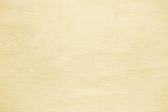 米黄墙壁纹理,背景上色了混凝土,水泥摘要 库存照片