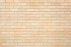 米黄砖铺磁砖了墙壁纹理背景 免版税库存图片