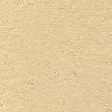 米黄纸板米加工印刷纸纹理,明亮的概略的老被回收的织地不很细空白的空的难看的东西拷贝空间背景,大年迈 免版税库存图片