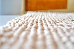 米黄色的地毯 库存图片