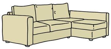 米黄长沙发 免版税库存照片