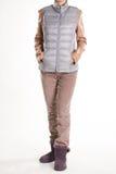 米黄长裤和双色的外衣 图库摄影