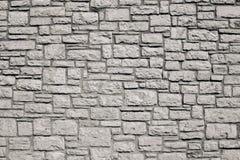 从米黄颜色一块石砖的老墙壁  库存图片