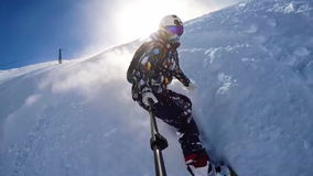 粉末的雪板运动女孩在头戴盔甲的阿尔卑斯 影视素材