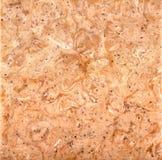 粉红棕褐色的石背景 免版税库存照片