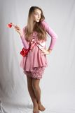 粉红色的十几岁的女孩与长毛绒重点 免版税库存图片
