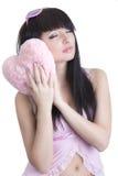 粉红色的美丽的休眠的妇女 免版税图库摄影