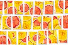 粉红色葡萄柚和桔子混合五颜六色的被切的果子拼贴画 库存图片