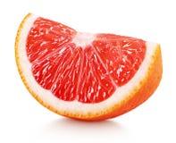 粉红色葡萄柚在白色隔绝的柑桔楔子  免版税图库摄影