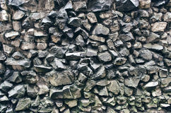 粗砺的岩石墙壁 免版税库存照片