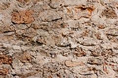 粗砺的石墙 免版税库存照片