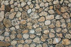 粗砺的石纹理墙壁 库存照片