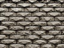 粗砺的石头墙壁在背景中 免版税库存照片