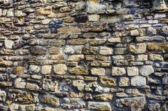 粗砺的葡萄酒石墙 免版税库存照片