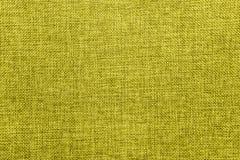 粗麻布背景在黄绿色混合上色了 免版税库存照片