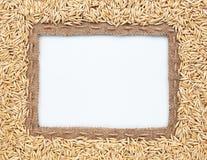 粗麻布和燕麦豆框架  免版税库存图片