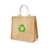 粗麻布或黄麻购物袋与回收标志 库存图片