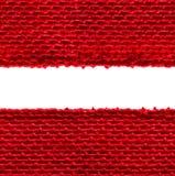 粗麻布无缝的织品边缘纹理,袋装的布料边界,红色 免版税图库摄影