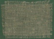 粗麻布织品被撕毁的边缘 免版税库存图片