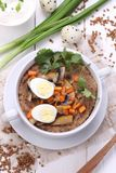 粥用蘑菇和鹌鹑蛋 免版税库存图片